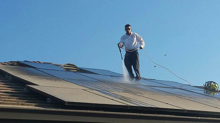 Power washing pigeon dropping off solar panels and roof.